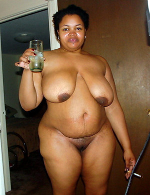 Black cheerful BBW big brown nipples..