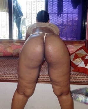 Big ass black BBW in golden thong..