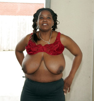 Black mature woman shows huge breasts..