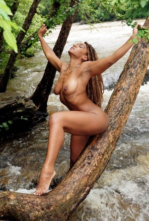 Beautiful black milf posing on a..