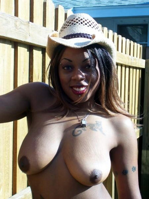 Titted black milf in a cowboy hat