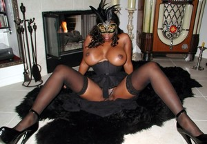 Busty black housewife in big mask...